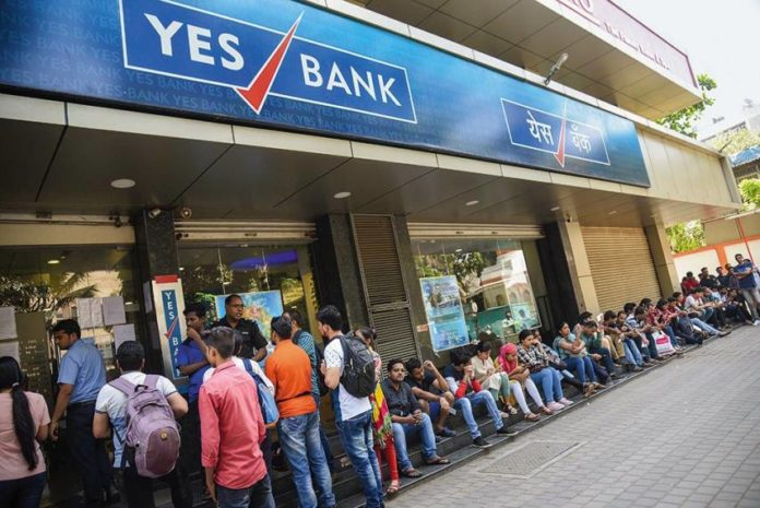 Queuing up concerned depositors outside a Yes Bank branch after knowing about the crisis. (Photo Credit: Outlook)