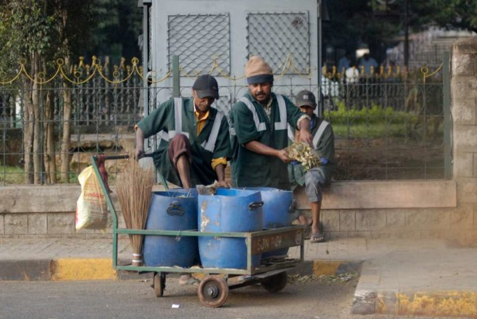 Sanitation workers on job. Photo courtesy Flickr