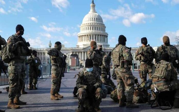 United States National Guard troops gather in front of the US Capitol Hill (Image credit: The Guardian)