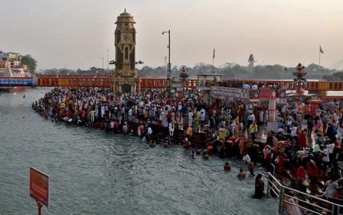 Pilgrims take holy dip in the Ganga on the occasion of Somvati Amavasya in Haridwar on Monday (Image credit: Reuters)