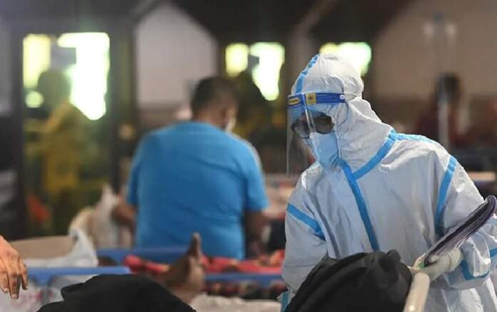A doctor in PPE Kit attending a COVID-19 patient (Image credit: NDTV.com)