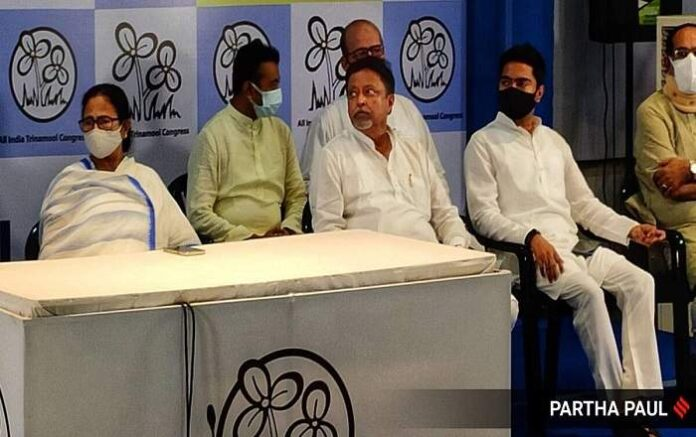 Mukul Roy with West Bengal chief minister Mamata Banerjee, his son and others (Image credit: The Indian Express)