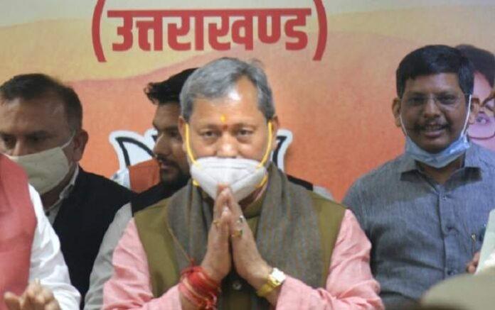 Uttarakhand chief minister Tirath Singh Rawat (C) (Image credit: The New Indian Express)